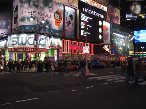 Times square at night (with Lucky in the background).